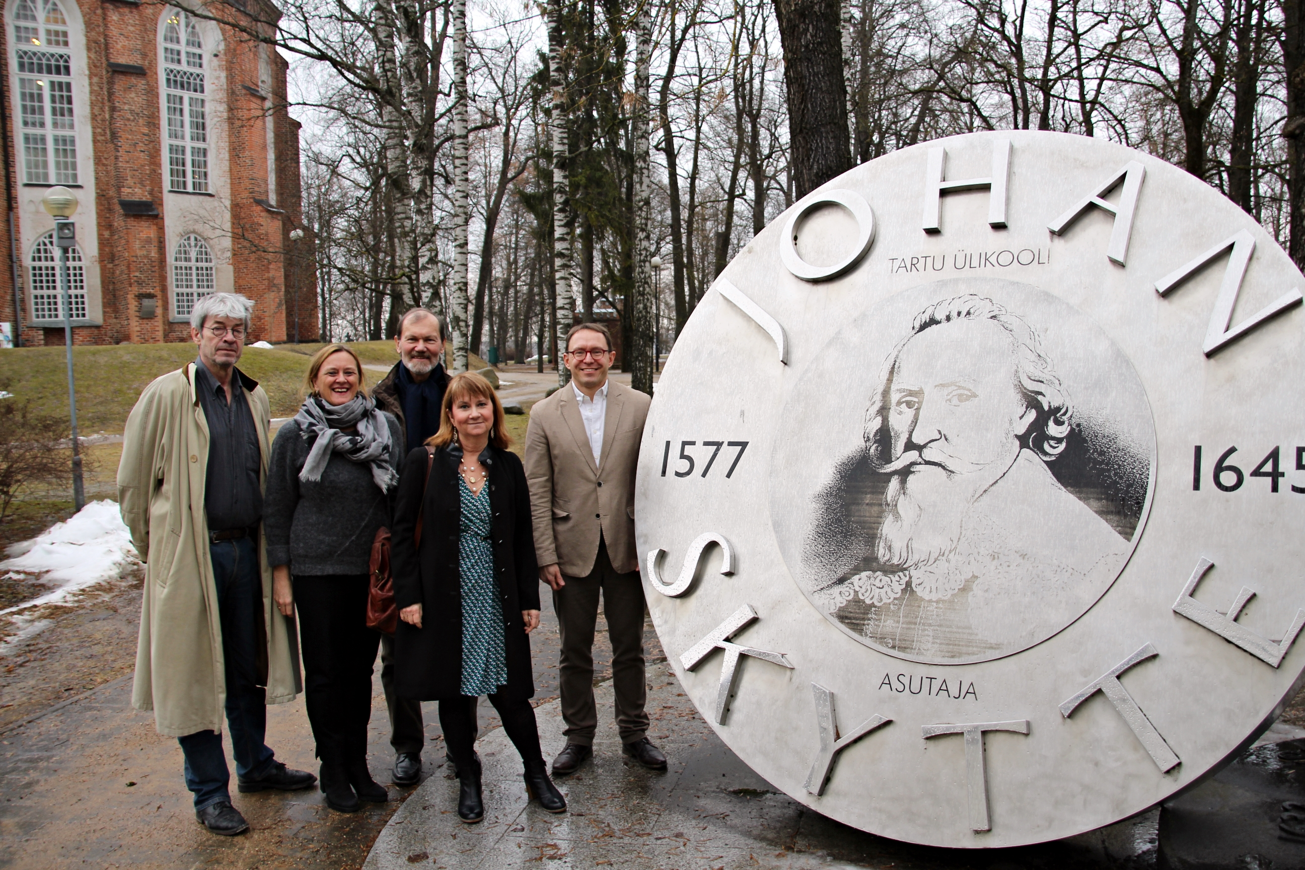 Five of the 6-strong Skytte Prize Committee by the Skytte Memorial in Tartu.